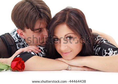 Young love couple with rose lying on  white background - stock photo