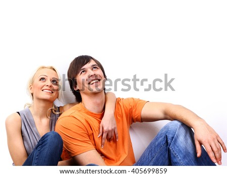 Young love smiling couple in the new flat
