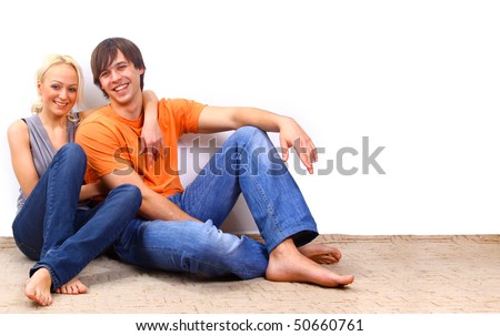 Young love smiling couple in the new flat - stock photo