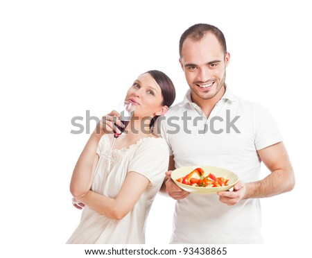 Young lovely couple cooking a balanced diet on a white background. Big copyspace - stock photo
