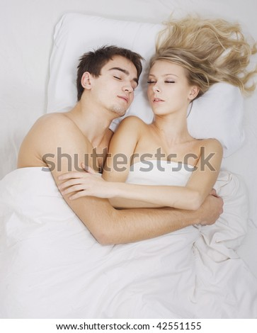 Young lovely couple sleeping together. - stock photo