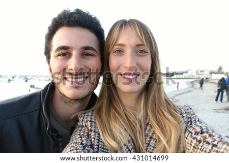 Young lovely couple taking selfie - stock photo
