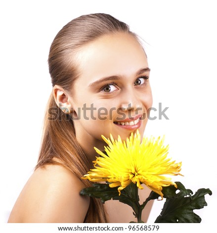 young lovely woman with yellow flower on a white background - stock photo