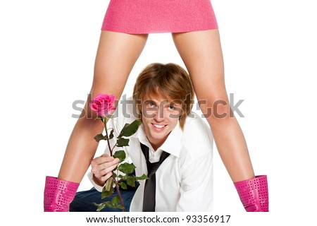 young lover man happy smile hold pink rose flower, lying under between woman sexy legs in skirt, concept of couple valentine's, greeting, valentine day love - stock photo