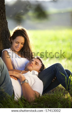 Young lovers couple enjoying each other outdoors - stock photo