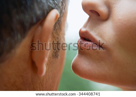 young lovers   secrets - stock photo