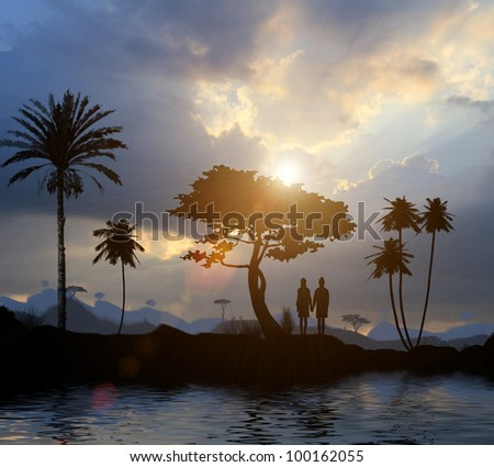 Young lovers stand near a tree by the lake at sunset