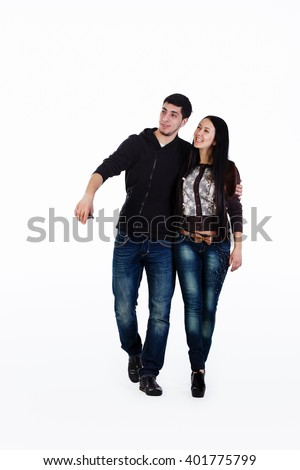 Young lovers walk their talk, they have fun. Shot in studio over white background.
