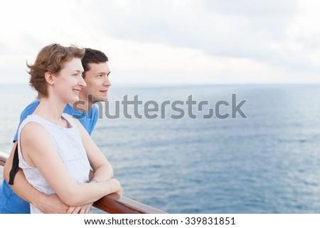 young loving couple enjoying caribbean cruise together - stock photo