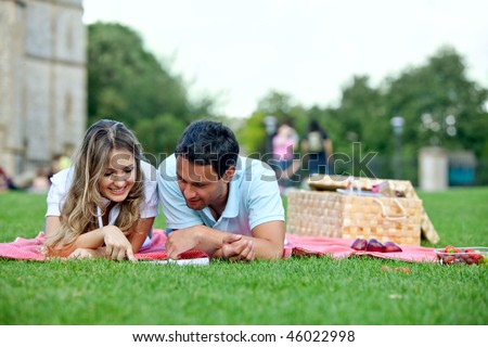 Young loving couple having a picnic outdoors