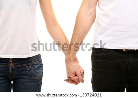 Young loving couple holding hands isolated on white