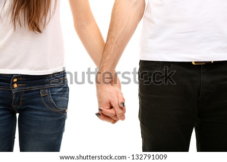 Young loving couple holding hands isolated on white - stock photo