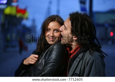 Young loving couple in a city. Biting a chick. - stock photo