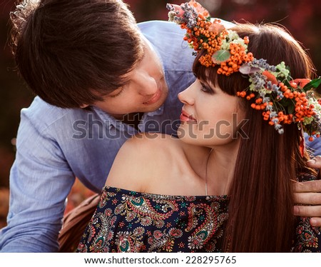 Young loving couple in autumn forest - stock photo