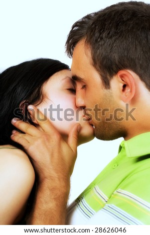 Young loving couple kissing, isolated on white - stock photo