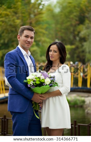 Young loving couple on a date on background of autumn park - stock photo