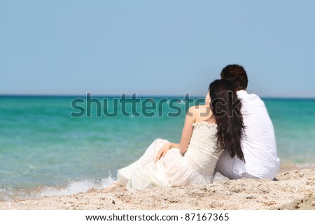 young loving couple on sea background - stock photo