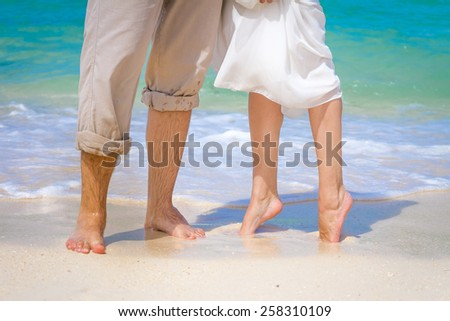 young loving couple on wedding day, outdoor beach wedding - stock photo