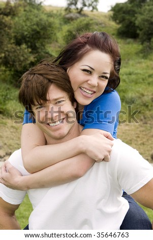 Young loving couple playing outside
