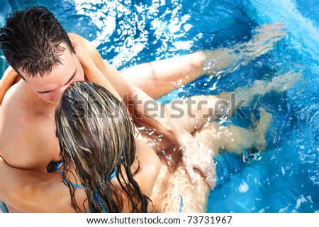 Young loving couple relaxing in a comfortable  jacuzzi. - stock photo