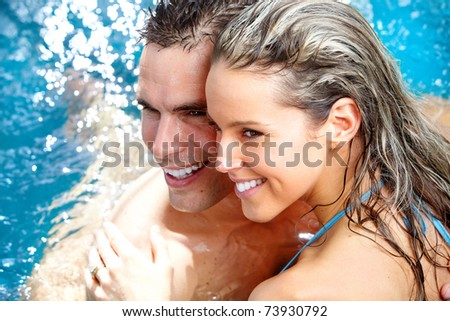 Young loving couple relaxing in the water. Vacation. - stock photo