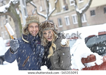 Young loving couple smiling happy at wintertime, embracing. - stock photo