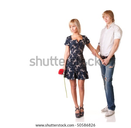 young loving couple together on white background - stock photo