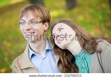 Young loving couple together outdoors - stock photo