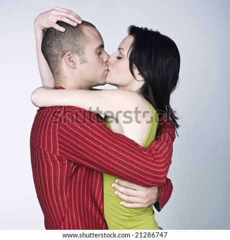 young loving kissing couple on isolated background - stock photo