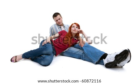 young loving people sitting on the floor r - stock photo