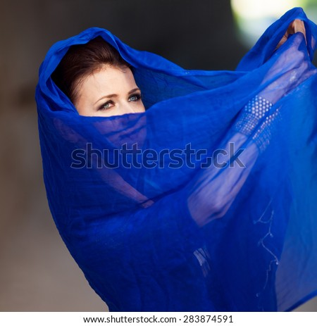 Young luxurious model in blue dress posing outdoor - stock photo