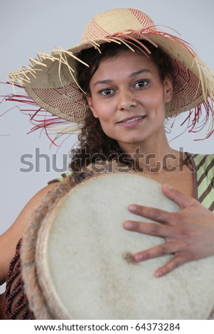 Young M?tis woman with percussions - stock photo