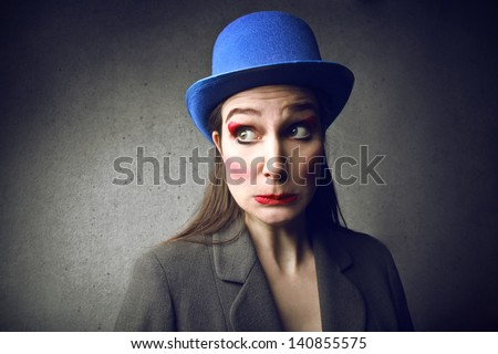 young magician with funny blue hat - stock photo
