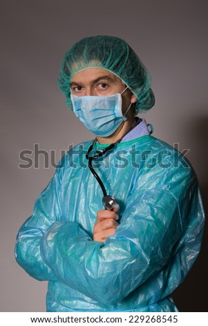 young mal doctor, on a dark background - stock photo