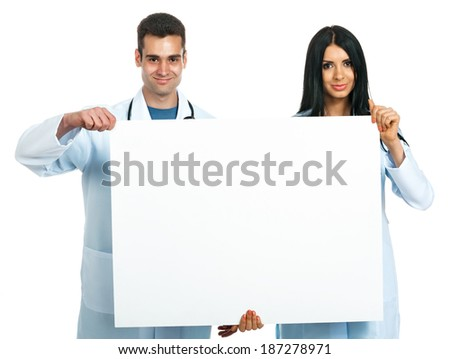 young male and female doctors (students, interns, nurses) with a blank board - stock photo
