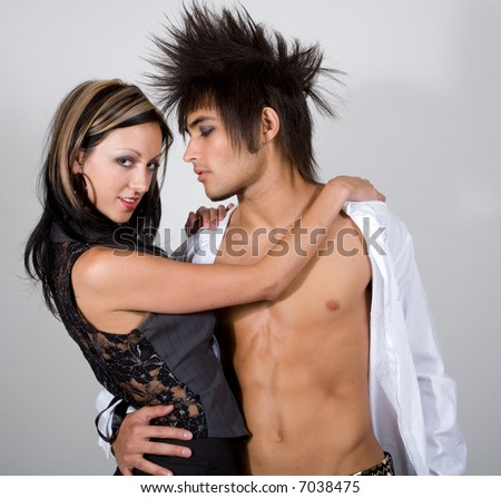 Young male and female urban couple in coy pose