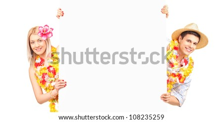 Young male and female wearing flower lei and holding a white panel - stock photo