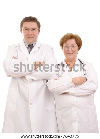 Young male and senior female doctors standing side by side over white background