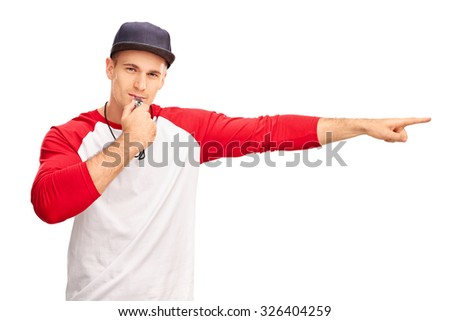 Young male baseball referee blowing a whistle and pointing with his hand isolated on white background - stock photo