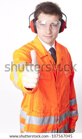 Young male builder showing thumb up. - stock photo