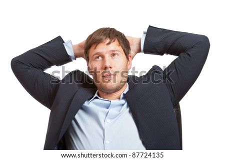 Young male business man thinking or dreaming - stock photo