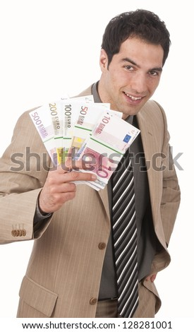 Young male businessman in light suit waving banknotes, isolated against white background