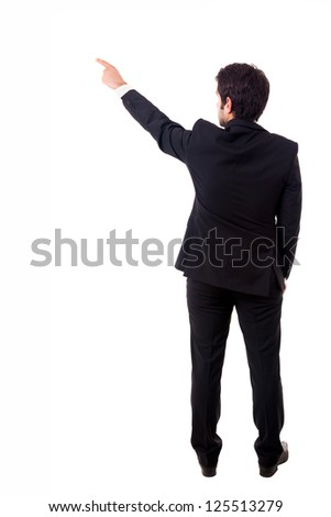 Young male businessman pointing at copyspace over white background - stock photo