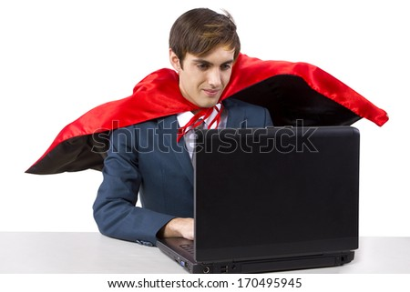 young male businessman wearing a red cape - stock photo