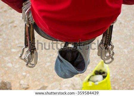 Young male climber hanging on a cliff with a rope. - stock photo