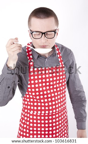 Young male cook checking his dish. - stock photo