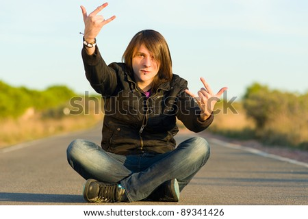 Young male demonstrating and showing his displeasure - stock photo