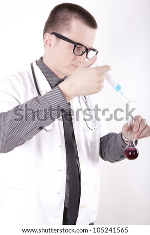 Young male doctor checking syringe and test tube working.