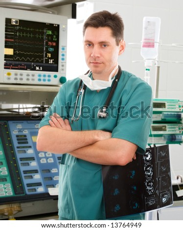 young male doctor in intensive care unit - stock photo