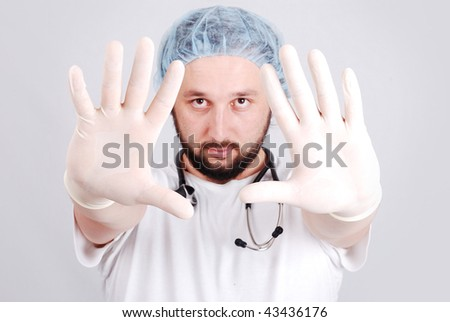 Young male doctor in white - stock photo